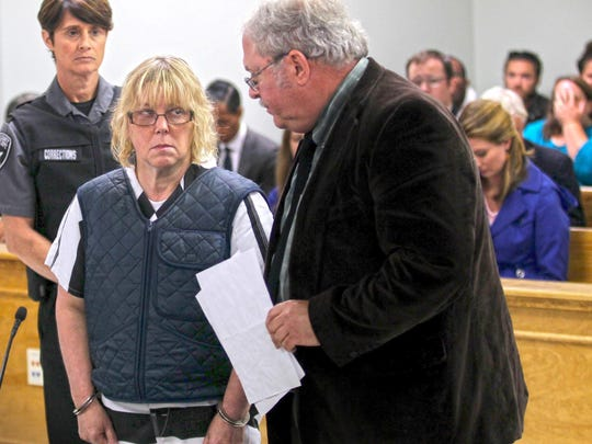 Joyce Mitchell appears with lawyer Stephen Johnston before Judge Buck Rogers in Plattsburgh City Court on Monday . Mitchell is accused of aiding inmates Richard Matt and David Sweat in their escape from Clinton Correctional Facility.