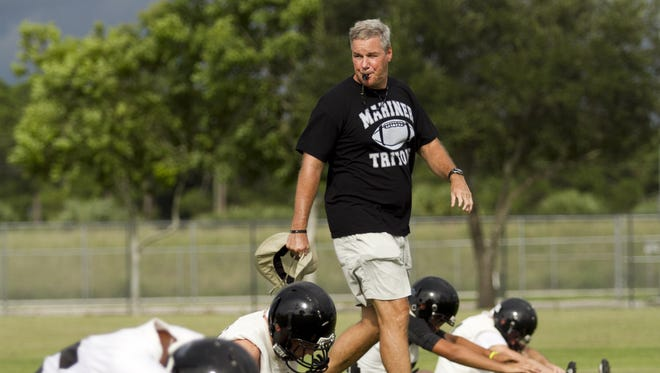 Mariner High School football coach, James Hale, coaches players through drills on the teams first day of football practice Monday at Mariner High School in Cape Coral.
