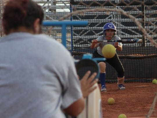 The Cavegirls work on bunting drills during Wednesday's