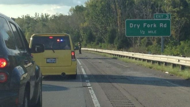 Police blocked off lanes of I-74 West near Dry Fork Road Sunday because of an apparent road rage shooting.