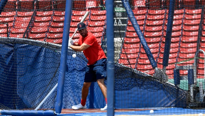 Red Sox left fielder J.D. Martinez takes batting practice at Fenway Park on Saturday.