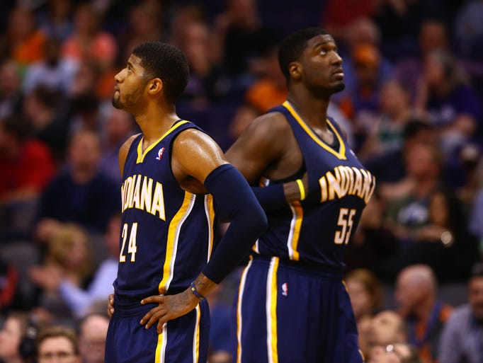 Indiana Pacers forward Paul George (left) and center Roy Hibbert react in the second half against the Phoenix Suns at US Airways Center. The Suns defeated the Pacers 124-100.