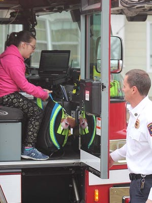 Abigail Hanke earned a ride on a fire truck by being the top fundraiser for the Riverside Elementary School 's Walk-a-Thon.
