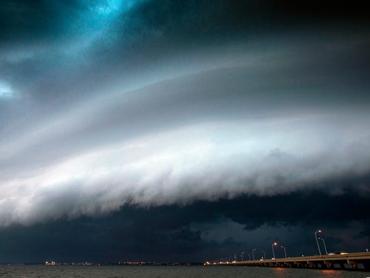 A thunderstorm rolls over Escambia County and moves towards the coastline in mid-June 2016.