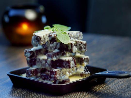 Kepta Duona, crispy rye bread tossed in duck fat aioli and Havarti cheese at Sonata's Restaurant in Scottsdale.