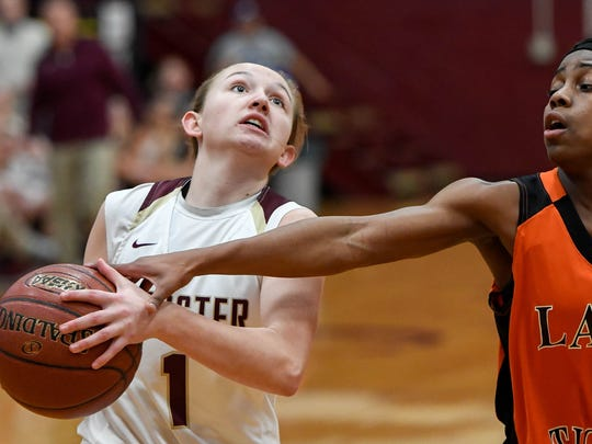 Webster County's Sadie Wurth (1) drives to the goal under pressure from Hopkinsville's Breon Oldham (5) as the Webster County Lady Trojans play the Hopkinsville Lady Tigers in the Second Region semifinals in Dixon Friday, March 2, 2018.