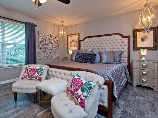 The master bedroom has cool transitional and ultra comfortable vibe with plenty of room to rest and relax