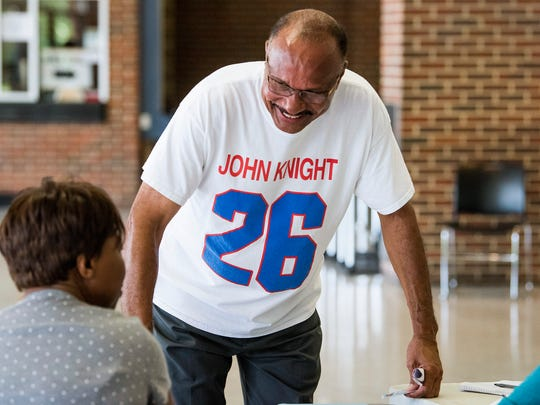 John Knight signs in to vote on his second attempt to be allowed to vote in Montgomery, Ala. on Tuesday July 17, 2018.