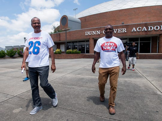John Knight, left, leaves after being allowed to vote on his second attempt in Montgomery, Ala. on Tuesday July 17, 2018.
