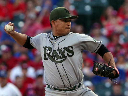 Tampa Bay Rays starting pitcher Erasmo Ramirez (30) delivers a pitch against the Texas Rangers in the first inning of a baseball game in Arlington, Texas, Monday, May 29, 2017. (AP Photo/Richard W. Rodriguez)