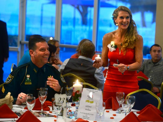 Escambia County Deputy, and TIP (Trauma Intervention program) honoree sergeant Vince Odenbrett chats with Deanna Smith, Executive Director of TIP Northwest Florida, Saturday during the 2016 Heores with Heart gala at the Pensacola Yacht Club.