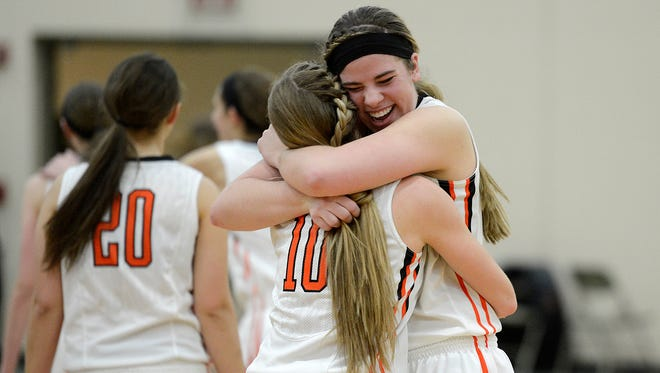 West De Pere's Taylor Strick (42) and Bailey Denis (10) hug as they celebrate their victory against Seymour during Friday night's game at West De Pere High School. Evan Siegle/Press-Gazette Media