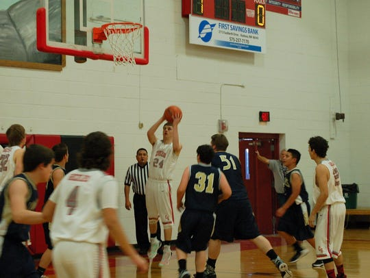 Carrizozo's boys, seen here in a 93-48 win over Valley