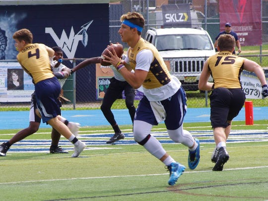 Wayne Valley quarterback Vinny Marrone looking for an open receiver during a 7-on-7 contest.