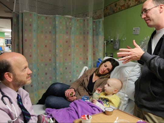 Dr. David Korones talks with Paul and LIz Conrow about Amanda's MRI results at Golisano Children's Hospital.