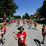 Members of Springfield's NAACP chapter march down Sherman Ave. during the Park Day Reunion parade in Springfield, Mo. on Aug. 1, 2015.