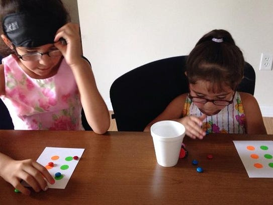 Sisters Alixon and Alexa Marcial Hernandez practice