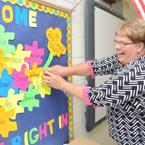 Princess Anne Elementary fifth-grade reading teacher Teresa Adkins sets up her classroom in anticipation of the upcoming school year across the Shore.