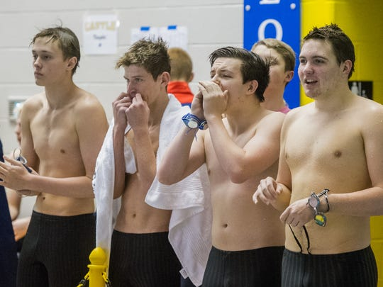 Members of the Reitz swim team (from left) Forest Wade, Tanner Bell, Jason Loesch and Matthew Daught cheer on teammate Graham Adye (not pictured) in the second heat of 100 Yard Butterfly at the IHSAA Boys Swimming and Diving Sectional at Castle High School pool in Newburgh, Ind. Saturday afternoon, Feb. 18, 2017.