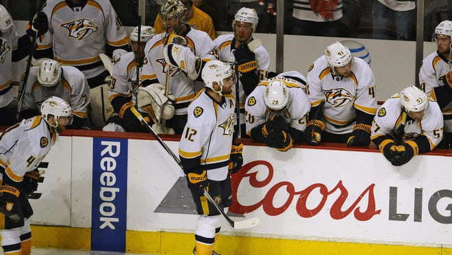 Predators players react after losing 4-3 to the Blackhawks in Game 6 of the first-round playoff series, ending their season, on April 25, 2015.