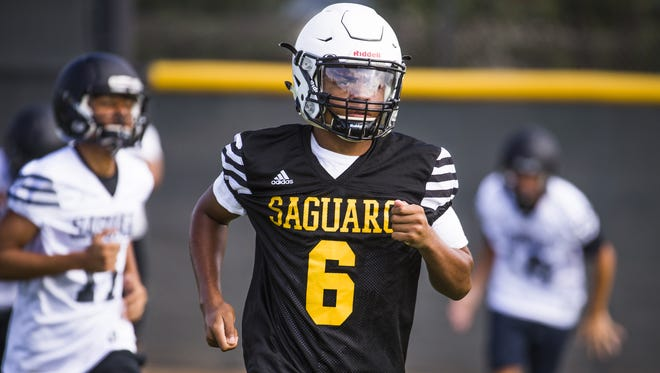 Saguaro High School wide receiver Jojo Patterson, #6, runs sprints at practice, Tuesday, July 25, 2017, at the school.