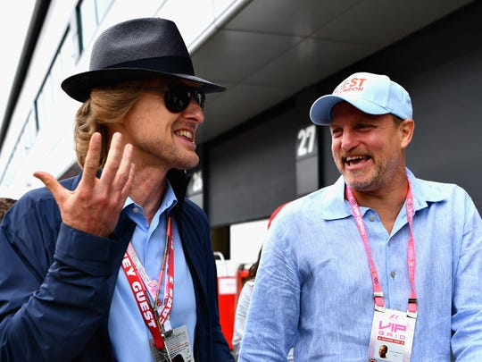 Actors Owen Wilson, left,  and Woody Harrelson walk in the Paddock before the Formula One Grand Prix of Great Britain at Silverstone in Northampton, England.