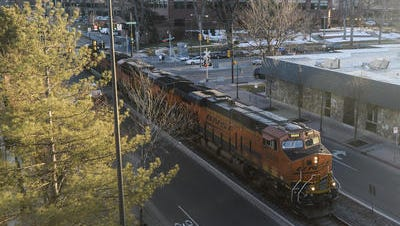 A Burlington Northern Santa Fe Railway train passes through Old Town on Mason Street in Fort Collins in this 2015 file photo. The city is working to establish a quiet zone for  the 12 crossings along the BNSF line.