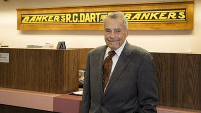 Rollin Dart, 89, chairman emeritus and community relations officer of Dart Bank is shown Tuesday at the main branch. He served as chairman from 1962 to 1999