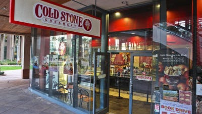 A Canadian company that operates more than 2,700 restaurants and fast-food outlets has agreed to acquire Kahala Brands, the Scottsdale-based parent of Cold Stone Creamery and other businesses.