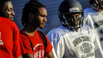 Hillside quarterback Tajae' Irby watches during the Snapple Bowl XXV practice for Union County on July 9.