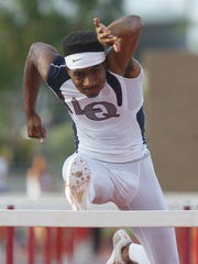 La Quinta High School's Koty Burton breaks the DVL record in the 110 meter hurdles of 14.11 with a time of 13.941 seconds at Palm Desert High School on May 4, 2016 during the DVL Finals.