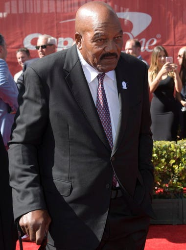 Former football player Jim Brown arrives on the red