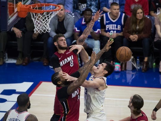 Sixers' Ersan Ilyasova (23) is blocked by the Heat