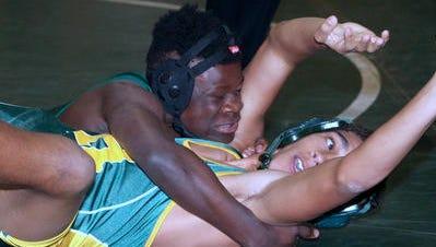 Woodlands' Sumner Kataka (top) is the Division 2 wrestling champion at 145 pounds.