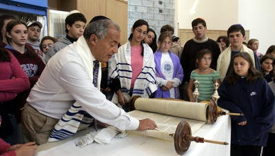 Rabbi Solomon Acrish reads the first verses of the Torah at Temple Beth Elohim's new synagogue in Southeast on Oct. 15, 2006. He died on Sunday, May 22, 2016, at 76.