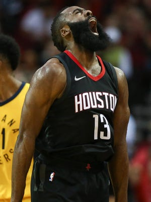 Houston Rockets guard James Harden (13) celebrates after scoring a basket during the third quarter against the Indiana Pacers at Toyota Center.