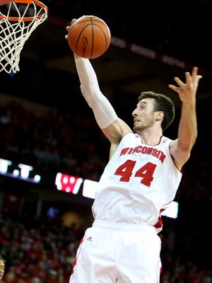 Wisconsin Badgers forward Frank Kaminsky (44) scores during the game against Buffalo at the Kohl Center.