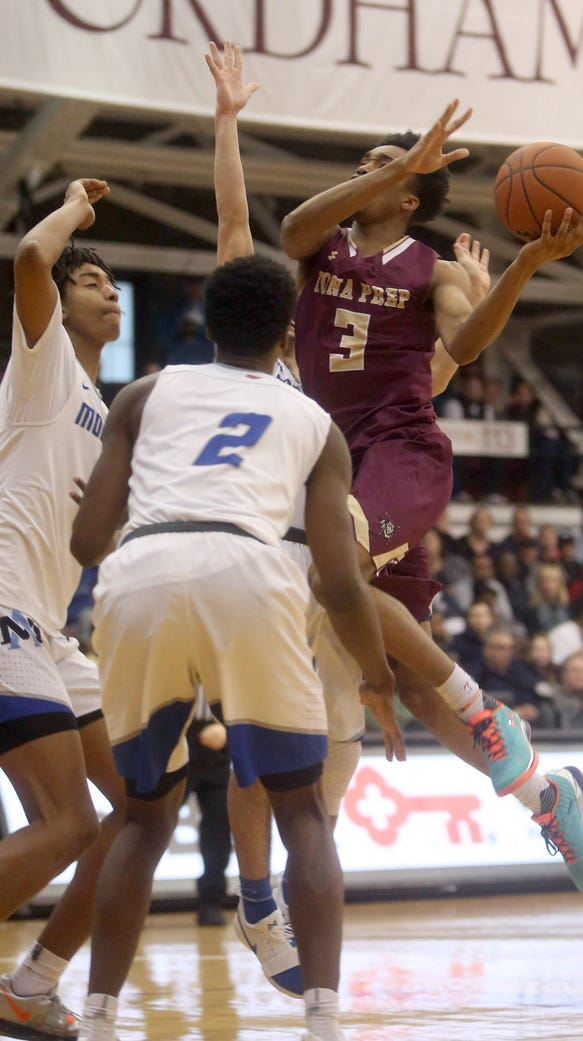 Bryce Wills of Iona Prep drives on Archbishop Molloy