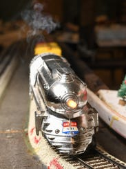 An American Flyer steaming engine moves around a track,