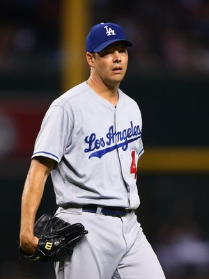 Los Angeles Dodgers pitcher Rich Hill reacts during a five-run first inning against the Arizona Diamondbacks at Chase Field.