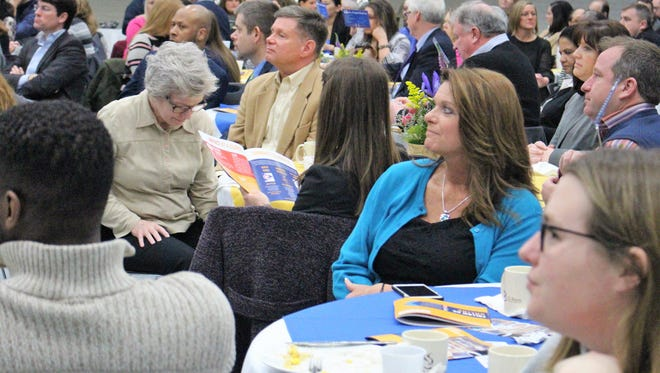 A crowd listens to the United Way of Marion and Wyandot Counties executive director Amber Wertman speak during an  event that honors the organization's community partners and investors.