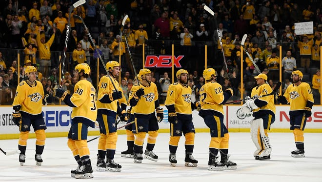 Predators players celebrate their 3-1 win over the Jets on Tuesday at Bridgestone Arena.