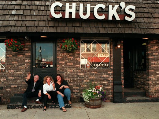 Linda Bisignano, middle, sits outside Chuck's on Aug. 1, 1996, with her big brother Gary Bisingano, left, and his daughter, Sarah Bisignano, as they laugh and wave to passers-by.