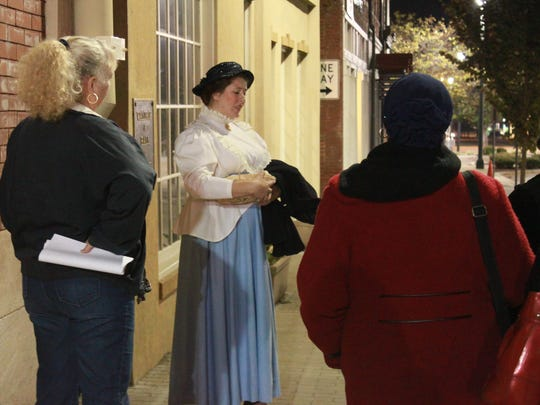 Misha Barbour plays the ghost of Mary Sypert Curtiss Friday at the annual Downtown Ghosts-A-Walking Tour.