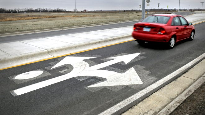 A car moves through the recently-completed roundabout at County Road 133 and 19th Ave. North in Sartell. The new Stearns County transportation plan approved Tuesday puts more focus on maintenance and preservation and less on projects related to expansion and growth.