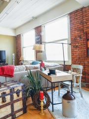 Wood and exposed brick lend character to the apartment.