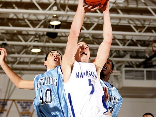 Manasquan Matt Vadas (5) grabs a rebound against Freehold Township in 2009.
