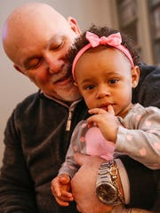 Gar King, father of Jordan King, holds his 17-month-old