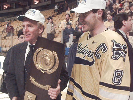 Berenson holds his second NCAA championship trophy
