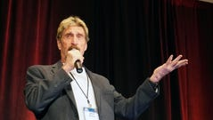 Computer security expert John McAfee discusses mobile-device flaws at an information-security conference in Denver on Wednesday.
